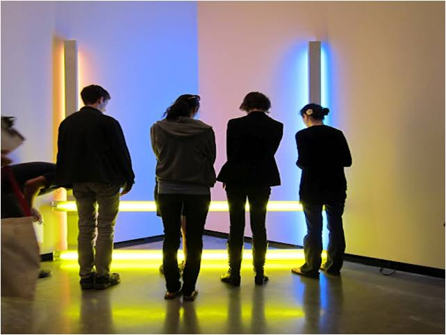 """Students interact with Dan Flavin's """"Untitled (to Donna) 2"""" (1971) at the Portland Art Museum. Photo by Sarah Wolf Newlands."""