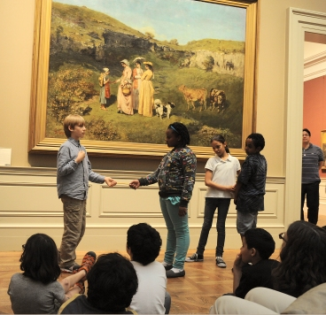 Students creating a tableau at the Met. Photo by Don Pollard.