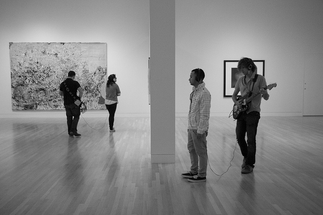 Machine Project's Live Museum Soundtrack at the Hammer Museum. Guitarist Eric Klerks improvises music for each artworks this visitor views.