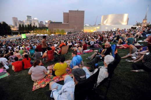 "An estimated crowd of 6,000 gathered at sundown outside the Walker Art Center in Minneapolis for the first ""Internet Cat Video Film Festival,"" August 2012."