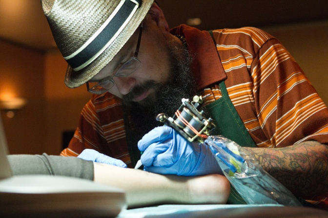 Museum visitors receive tatoos based on works of art in the Portland Art Museum's collection as part of a Shine a Light project by artist Jason Sturgill.