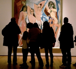"Visitors crowd around Picasso's ""Desmoiselles D'Avignon"" at Museum of Modern Art in New York,"