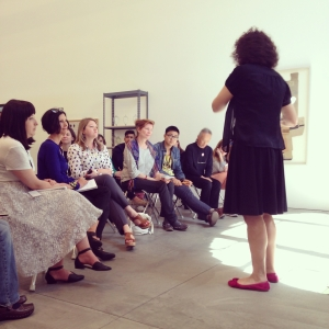"""Liz Diament leading part of a gallery teaching experience with Ai Weiwei's """"Marble Chair."""""""