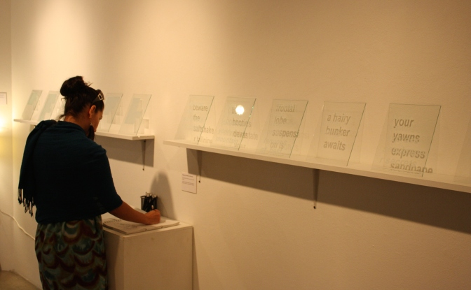 "Visitor participating with Kristen Cochran's ""Notes to self"" from the exhibition [IN]Translation ARTIST WEBSITE:  http://kristencochran.com/home.html"