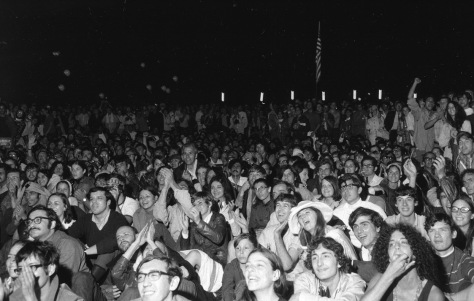 Ten thousand spectators gathered to watch giant television screens in New York's Central Park and cheer as astronaut Neil Armstrong took humanity's first step on the moon on July 20, 1969.
