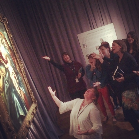 Portland Art Museum's Education team saying a dramatic goodbye to El Greco on its last day on view. Photo by Mike Murawski.