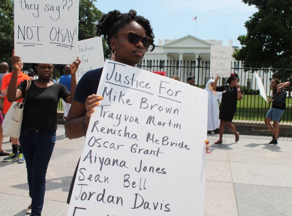 """Mike Brown Silent Protest White House"" by Elvert Barnes, CC BY 2.0"