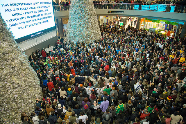 """A Black Lives Matter protest of police brutality in the rotunda of the Mall of America in Bloomington, Minnesota"" by Nicholas Upton, CC BY-SA 2.0"
