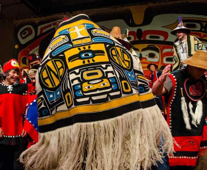 Ishmael Hope dances with the Shx'at Kwáan chilkat robe during the Shx'at Kwáan dance performance on Thursday at Centennial Hall during the Sealaska Heritage Institute Celebration 2014.