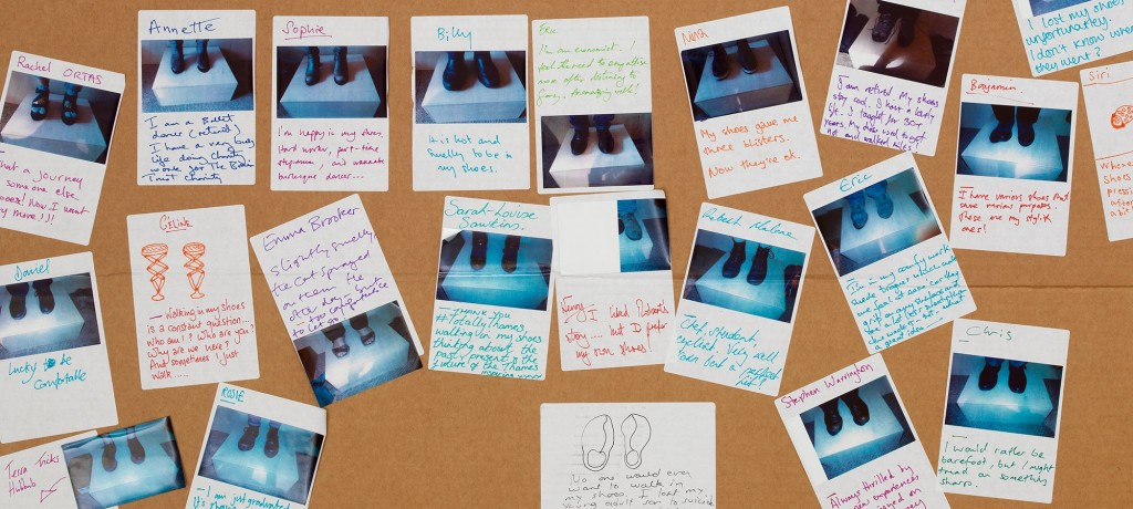 """Photo of stories written by visitors participating in the """"A Mile in My Shoes"""" exhibit"""