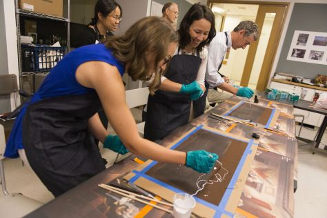 Staff explore Pollock's materials in a studio session, led by Assistant Curator of Conservation Cindy Schwarz (not pictured.)